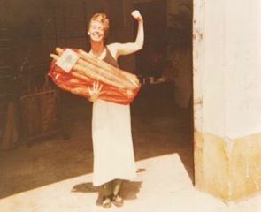Sarah in 1987, with an armful of bread.