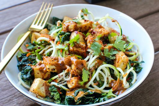 Pan Fried Crispy Tofu and Zoodle Bowl with Spicy Peanut Sauce