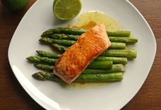 Pan-seared salmon with brown butter lime sauce and roasted asparagus