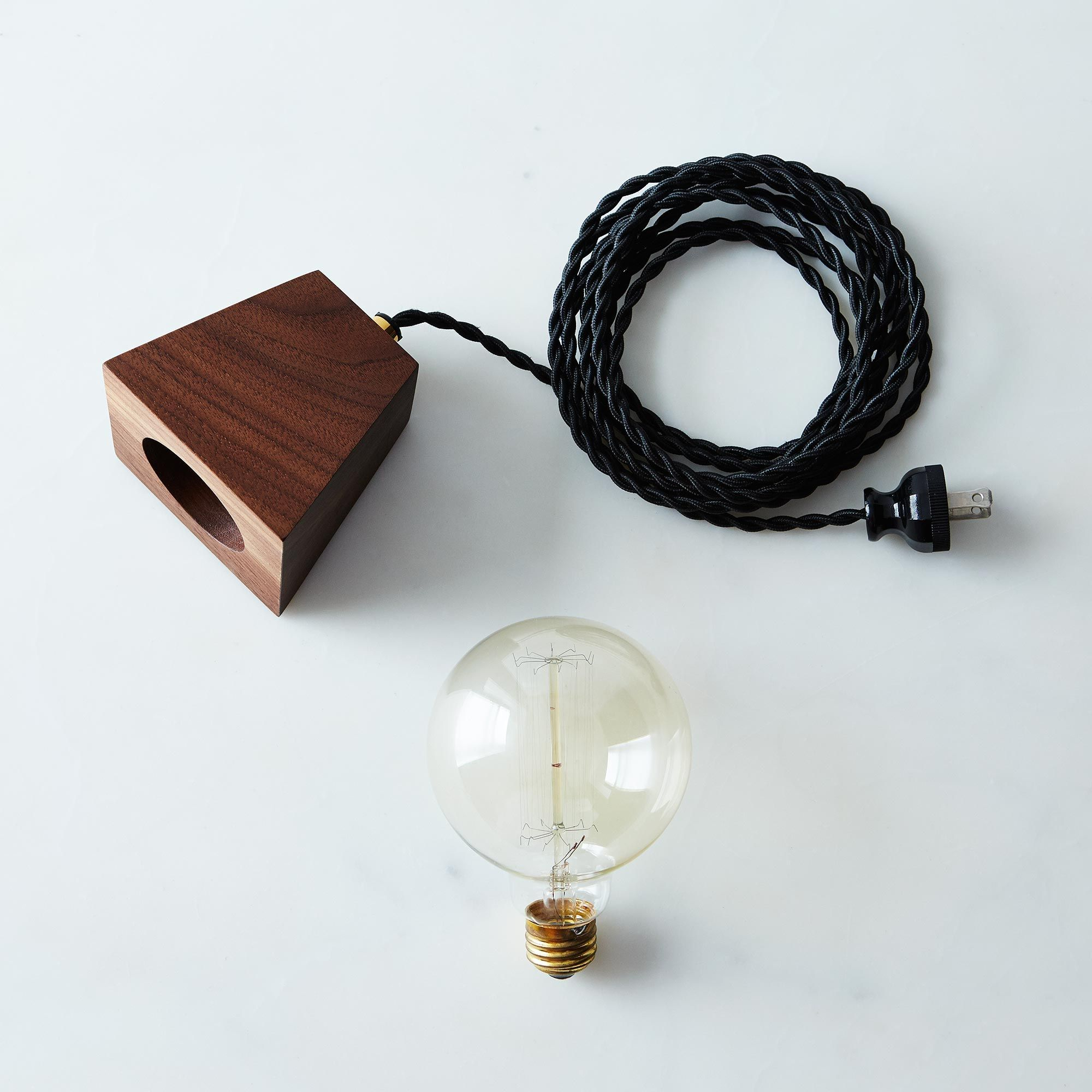 51544130 a0f7 11e5 a190 0ef7535729df  tight rope designs edison bulb wood block lamp walnut skinny bulb provisions mark weinberg 06 11 14 0802 silo