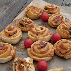 Leek and cheese rolls with anchovies topping