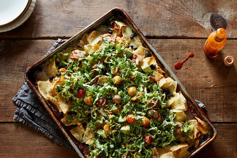 A Case for Putting Salad On Top of Your Nachos (And Eating Them On The Couch)
