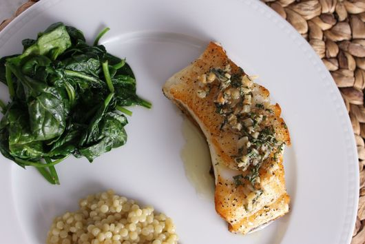 Chilean Sea Bass w/ Fresh Herbs & Sauteed Garlic