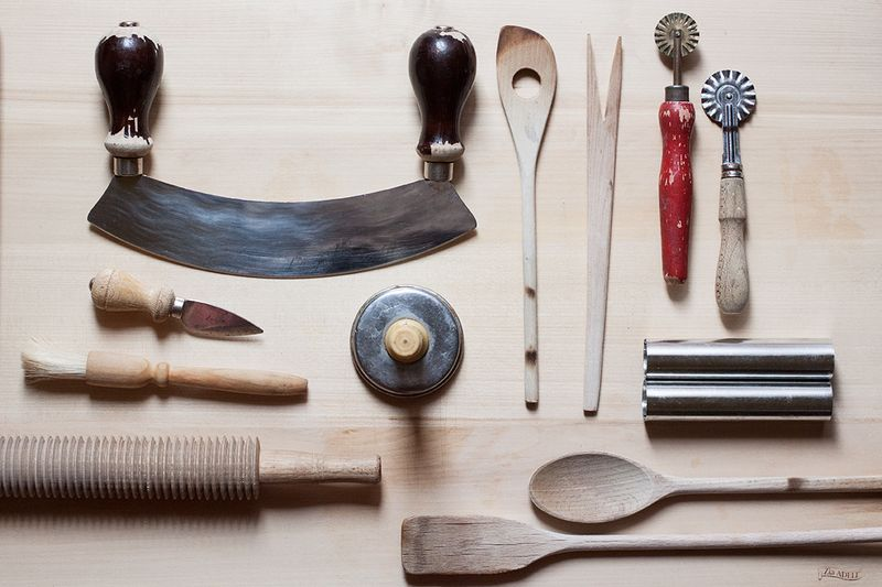 A mezzaluna, wooden spoons galore, metal tubes for making cannoli, a knife for Parmesan, a rolling pin and fluted wheels for making pasta—just a few of Emiko's favorite things.