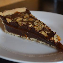 Sticky caramel and chocolate ganache tart