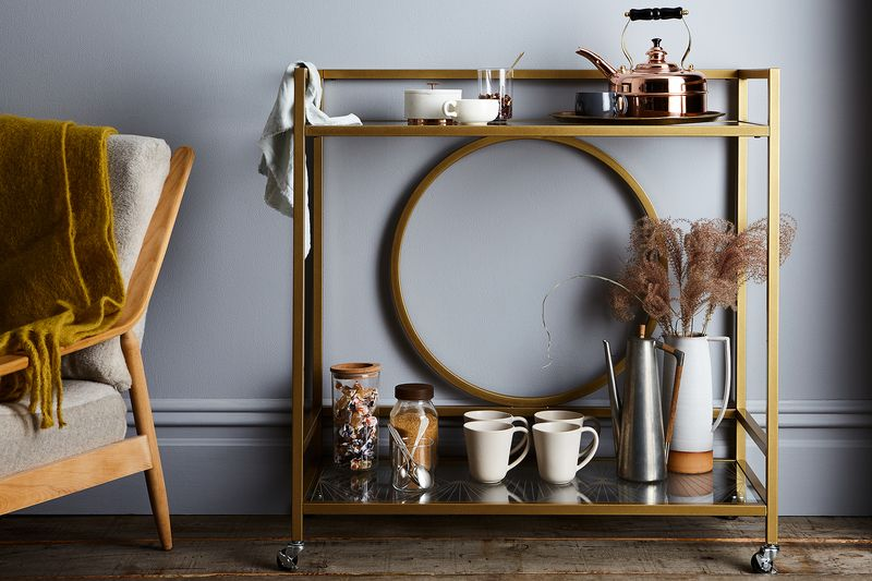 "A bar cart—like the International Lux Bar Cart from Sauder—elevates your teatime to ""high tea."""