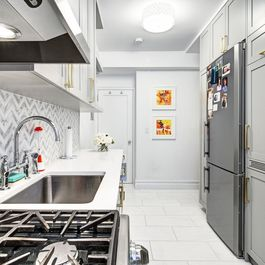 A Laundry Room So Tidy It Fits in the Kitchen