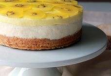 Kiwi mousse ginger cheesecake with an almond shortbread crust