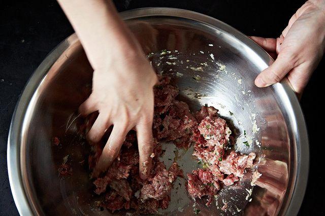 mixing meatballs