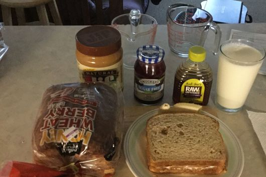 Peanut butter, honey, banana and jelly sandwich