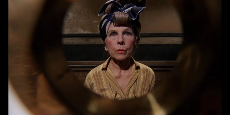 Minnie Castevet (Ruth Gordon) peering into Rosemary's apartment.