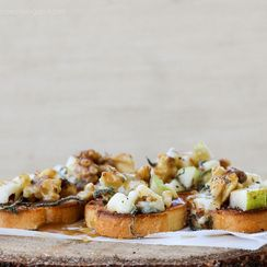 Pear, Walnut, & Bleu Crostini with Salted Maple Caramel Drizzle