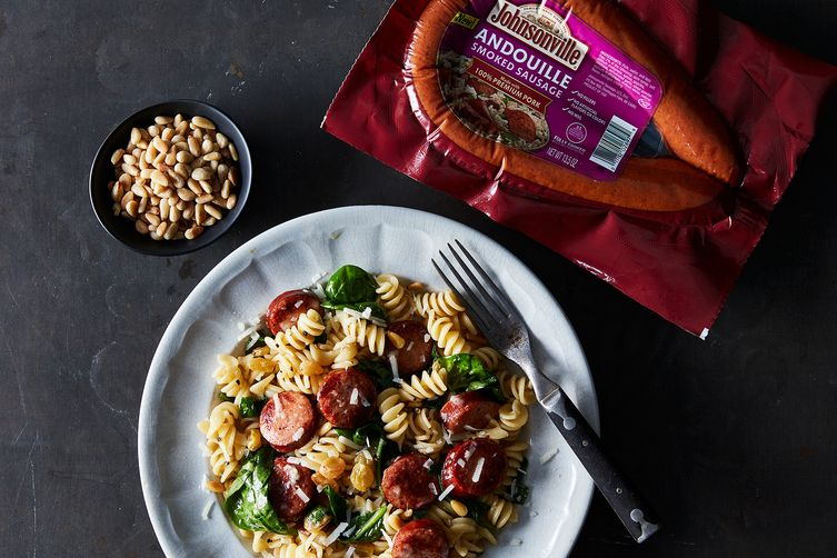 Rotini with Andouille, Pine Nuts, Raisins and Spinach