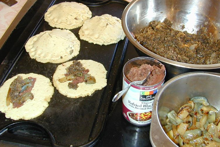 Pupusas stuffed with sauted mushrooms and pesto