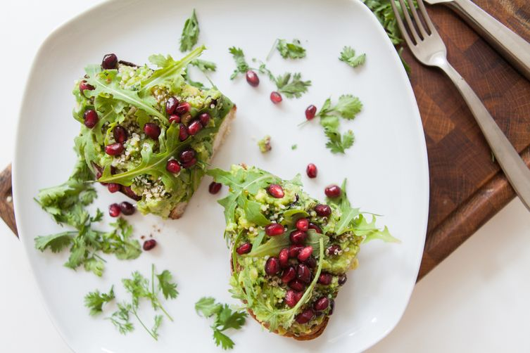 Superfood avocado toast with pomegranate seeds