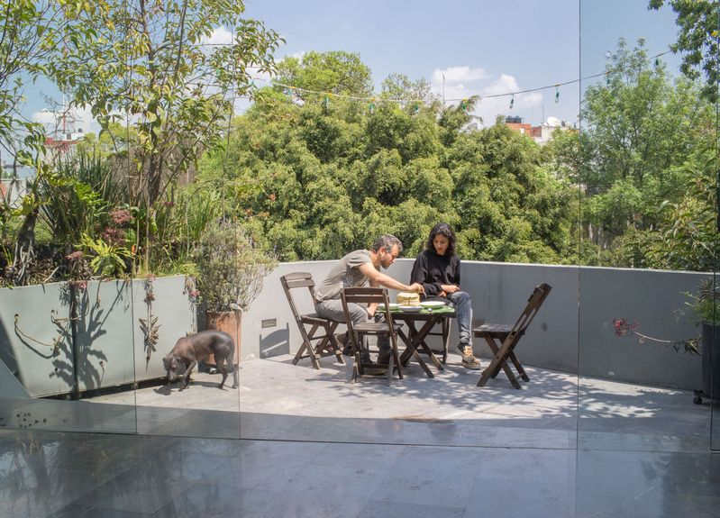 Yoshua Okón and his wife Mariana Vargas in their Mexico City home.
