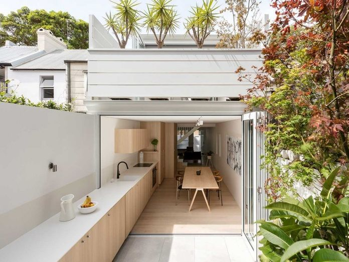 An Indoor-Outdoor Kitchen That Opens the Whole Room Up + Other Design Stories We Love