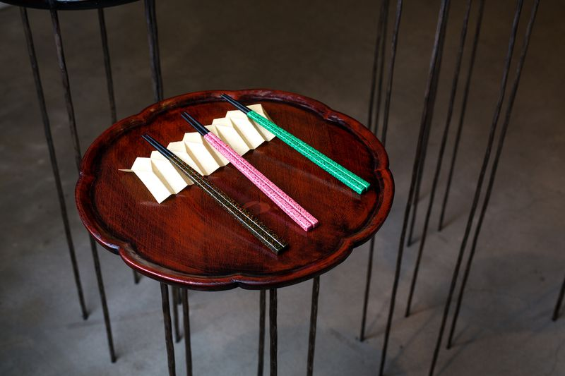 Park Yeon-ok and her daughter collaborate with local artisans to make the chopsticks.