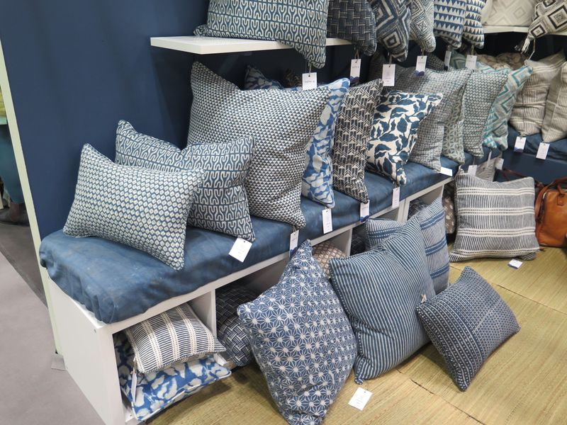 Hand-blocked printed pillows in a range of blues and grays at Walter G.