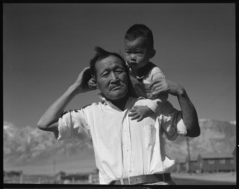 A grandfather and grandson at Manzanar Relocation Center in Manzanar, California.
