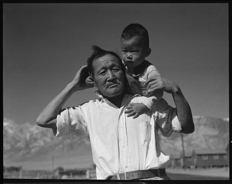 A grandfather and grandson at Manzanar Relocation Center in Manzanar, California.