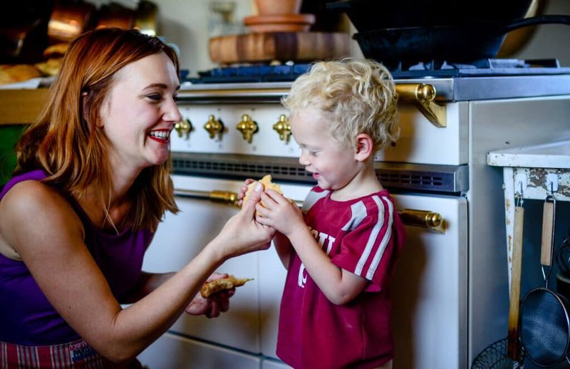 Shaye Elliott with her son (and her beautiful stove).