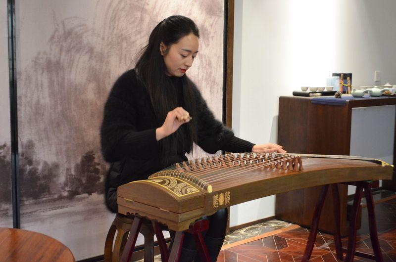 Playing a guzheng (Chinese piano)
