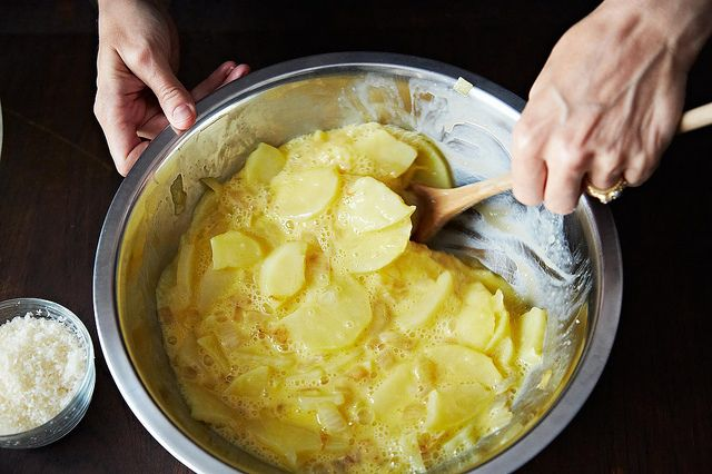 Gently mixing the egg and potatoes