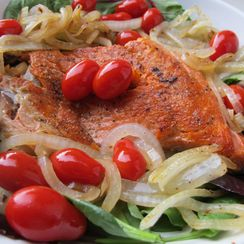 One-Pan Seared Salmon with Onions and Tomatoes on Lemony Greens