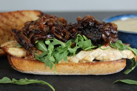 Grilled Chicken Sandwich with Arugula, Balsamic Glazed Onions, and Anchovy Aioli