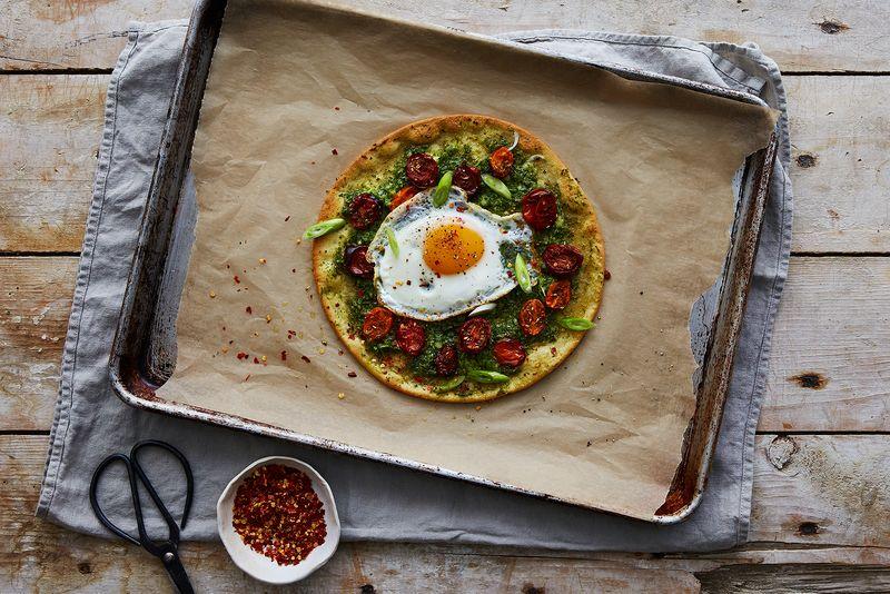 Ramp Pesto Pizza with Za'atar Roasted Tomatoes and a Runny Egg