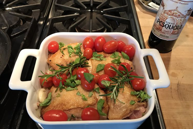 Roasted chicken thighs with cherry tomatoes