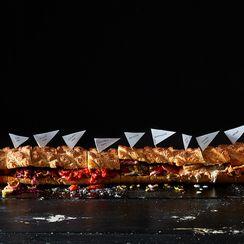 6 Game Day Snacks in 1 Humongo, Easily-Potlucked Sandwich