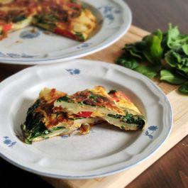 Spanish potato omelet with baby spinach and red pepper