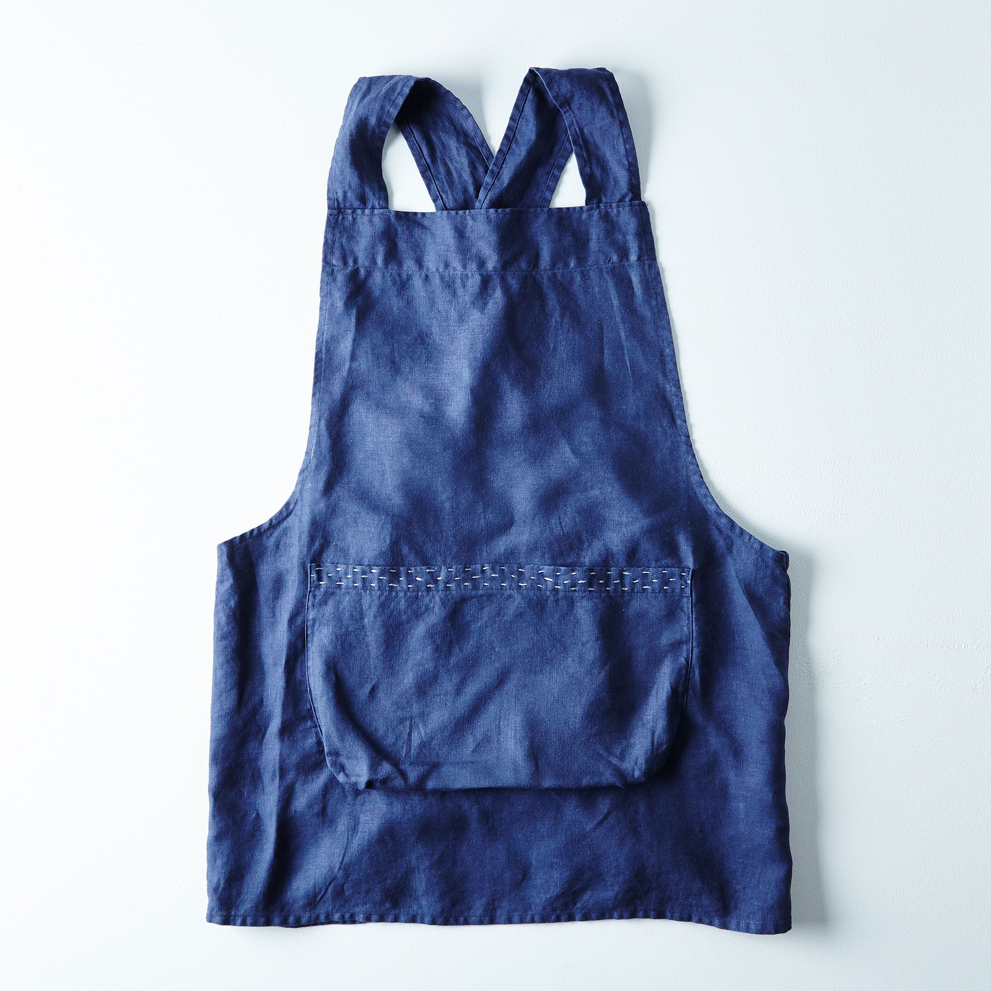 Abc84688 0b32 4cc5 aa14 25e9eaa6fd27  2015 0916 a good home hand embroidered navy linen apron silo rocky luten 010