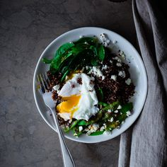Red quinoa salad with snow peas, spinach, feta and poached egg