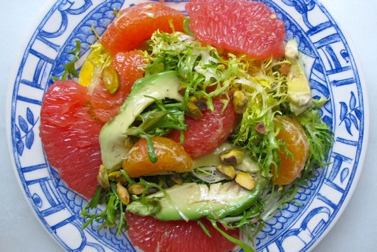 MIXED CITRUS AND AVOCADO ON A BED OF FRISEE