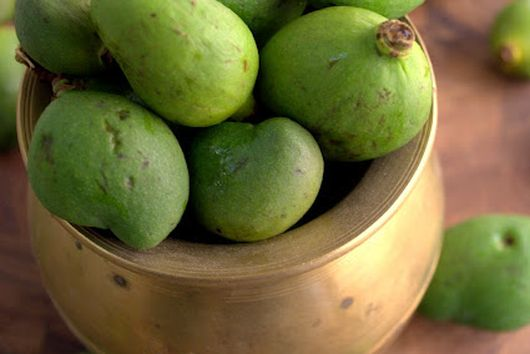 Pickled Baby mangoes in a chile mustard sauce (vadu Mangai)