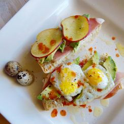 Avocado Tartine with Quail Eggs, Prosciutto & Goat Cheese