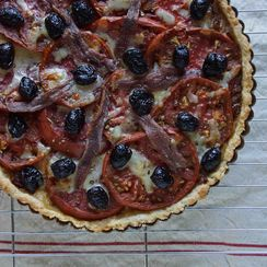 Tomato Tart with Caramelized Onions, Olives & Anchovies