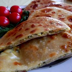 Georgian Khachapuri Filled with Ramps, Green Onions, Herbs, and Cheese