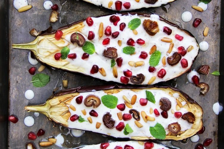 Aubergine with yoghurt sauce, pomegranate, dates and pine nuts