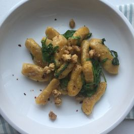3566849f b275 418a bfe5 141c726c9af0  pumpkin gnocchi pan fried in butter with arugula and spicy candied walnuts