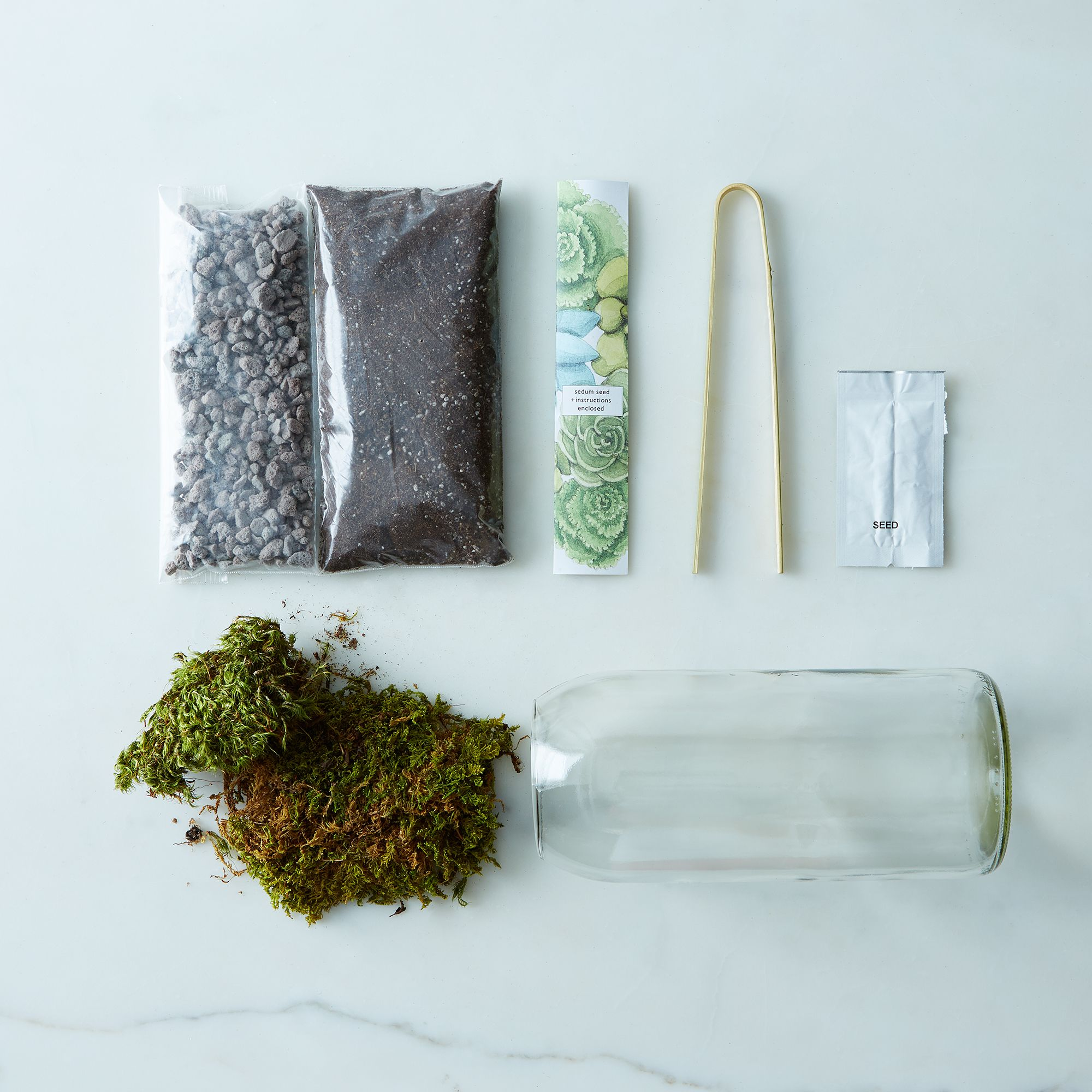 8768a046 6eef 49a8 becd ae96c563bd9b  potting shed creations moss sedum terrarium bottle provisions mark weinberg 03 09 14 0062 silo