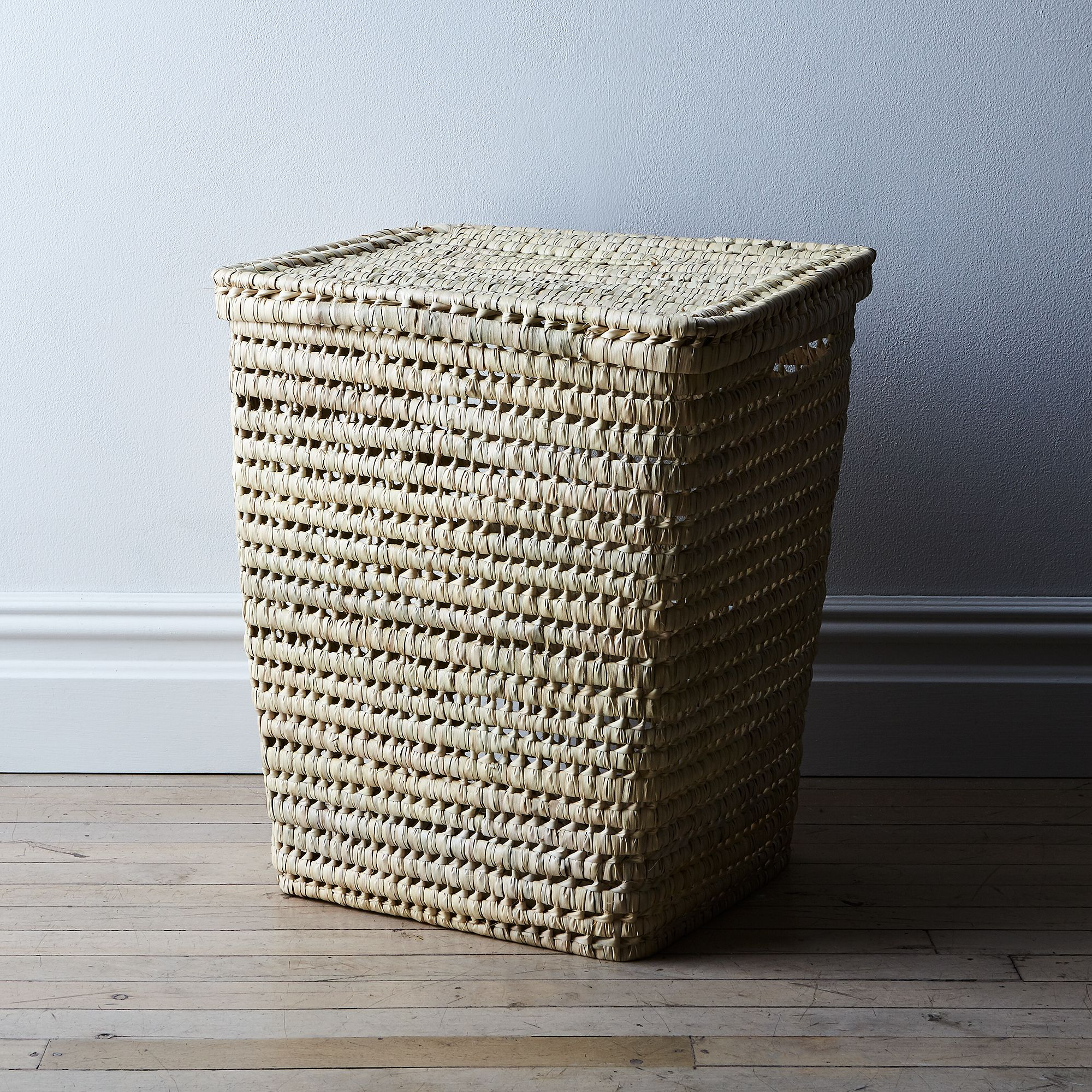 woven moroccan laundry basket with lid on food52