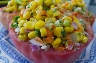 7f76b72f-cbc0-4441-b06d-855bfa434046.big_bertha_s_summer_tomatoes_stuffed_with_corn_and_herbs