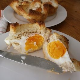 Baked Eggs in Toast Nests