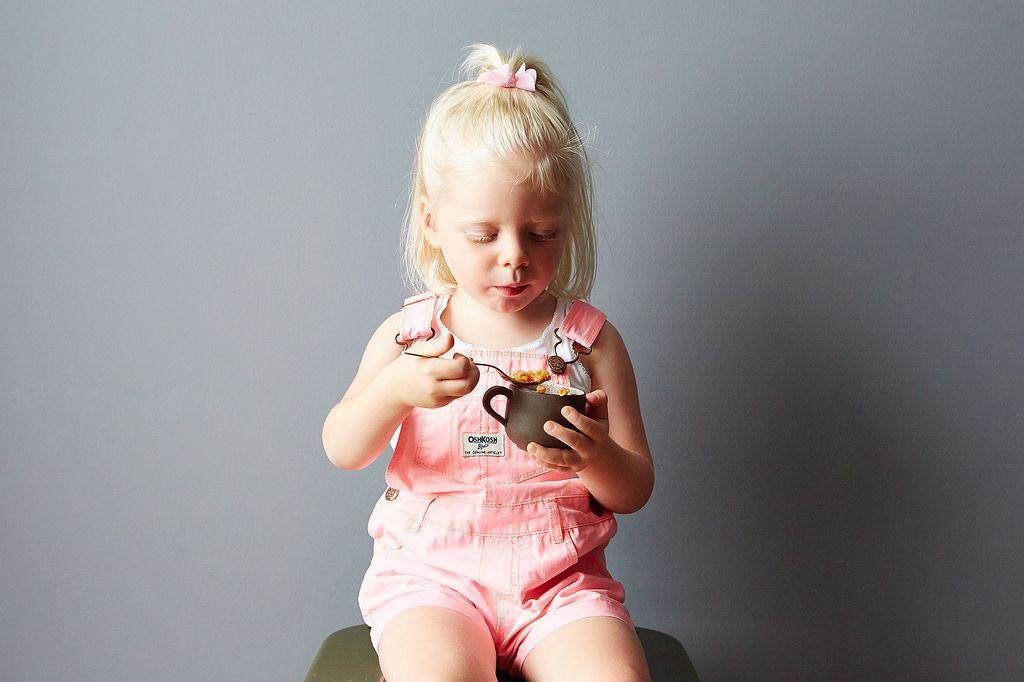 Little girl eating tomato rice