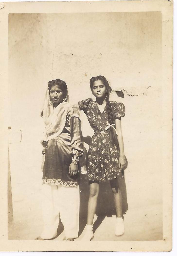 "From the book ""Sindh: Stories of a Vanished Homeland"" by Saaz Aggarwal. The author says: ""Koshi, in a dress and tennis shoes; Savitri, wearing traditional clothes, but you can't tell whether she is Hindu or Muslim."""