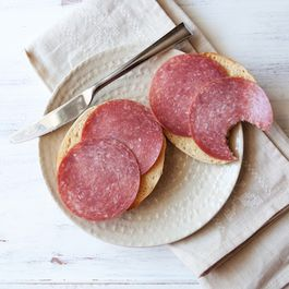 Bagel with butter and salami